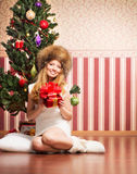 Beautiful teenager girl and the Christmas tree Stock Photo