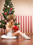 Beautiful teenager girl and the Christmas tree Royalty Free Stock Photography