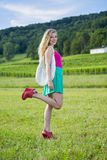 Beautiful teenager girl with colorful clothes Royalty Free Stock Image