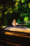 Beautiful teenager girl Is dancing outside at summer sunset stock images