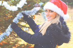 Beautiful teenager girl decorating the Christmas tree Stock Photography