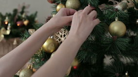 Beautiful teenager girl decorating the Christmas stock video