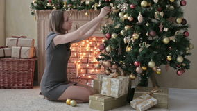 Beautiful teenager girl decorating the Christmas stock video footage