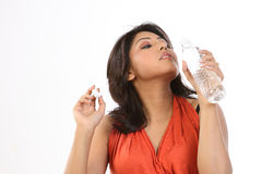 Beautiful Teenager Girl Drinking Water. On an Isolated Background Royalty Free Stock Image