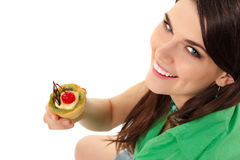 Beautiful teenager girl eating sweet cake Stock Photo