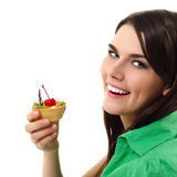 Beautiful teenager girl eating sweet cake. Isolated on white background Stock Photos