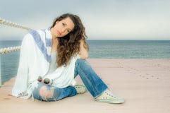 Beautiful teenager girl fashion portrait on a peer Stock Photography