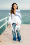 Beautiful teenager girl fashion shot on a peer Royalty Free Stock Photos