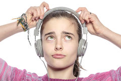 Beautiful teenager girl fumble on her headphones Stock Image