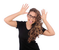 Beautiful teenager girl Gesture and Activity Teasing. Over white Royalty Free Stock Images