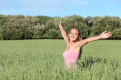 Beautiful teenager girl happy in a green meadow stock photography