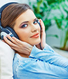 Beautiful teenager girl listening music. Stock Photography