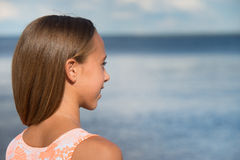 Beautiful teenager girl near the sea Royalty Free Stock Photography