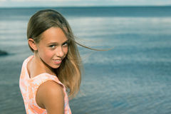Beautiful teenager girl near the sea Royalty Free Stock Images