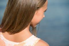 Beautiful teenager girl near the sea Stock Images