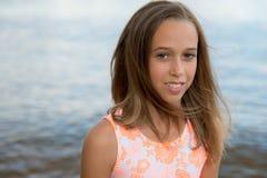 Beautiful teenager girl near the sea Royalty Free Stock Image