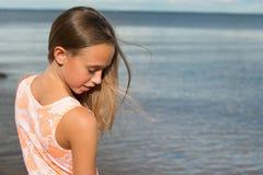 Beautiful teenager girl near the sea Stock Photo