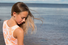 Beautiful teenager girl near the sea Royalty Free Stock Photos