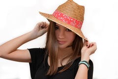 Beautiful teenager girl. Portrait of a cute friendly teenager girl with straw hat stock photos