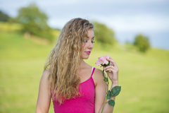 Beautiful teenager girl with rose Stock Photo
