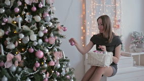 Beautiful teenager girl sorting out christmas stock video