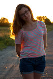 Beautiful teenager girl standing in sunset Royalty Free Stock Images