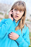 Beautiful teenager girl talking by cellular phone. Beautiful surprised teenager girl talking by cellular phone Royalty Free Stock Photography