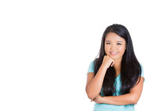 Beautiful teenager in happy thoughts with hand on chin Stock Photography
