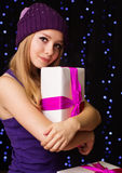 Beautiful teenager holding gift box with ribbon Stock Photography