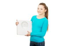 Beautiful teenager holding a scale. Stock Photos