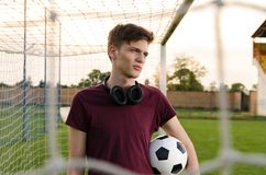 Beautiful teenager holding soccer ball royalty free stock photos