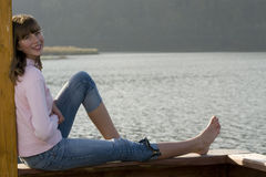 Beautiful teenager over lake Stock Photo