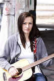 Beautiful Teenager Playing Guitar Stock Image