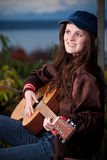 Beautiful teenager playing guitar Royalty Free Stock Image