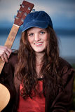 Beautiful teenager playing guitar Royalty Free Stock Photo