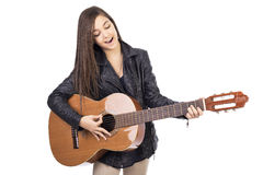 Beautiful teenager playing guitar and singing Stock Images