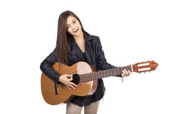 Beautiful teenager playing guitar and singing Royalty Free Stock Photos