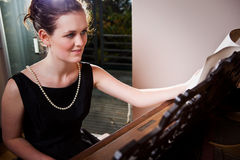 Beautiful teenager playing piano Royalty Free Stock Image