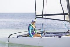 Free Beautiful Teenager Sailing Catamaran In Beautiful Sunset Stock Images - 105718194