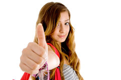 Beautiful teenager school girl showing thumbs up Stock Photography
