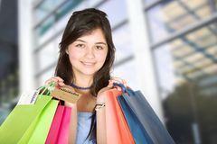 Beautiful teenager with shopping bags Stock Photos