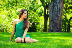 Beautiful Teenager Smiling Sitted on the Grass Stock Image