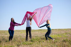 Beautiful teenager woman jumping with  tissue Royalty Free Stock Images