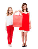 Beautiful teenagers holding shopping bag Stock Photos