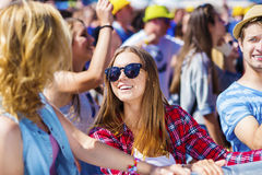 Beautiful teens at summer festival. Group of beautiful teens at concert at summer festival Stock Image
