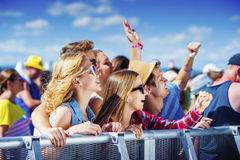 Beautiful teens at summer festival. Group of beautiful teens at concert at summer festival Stock Photos