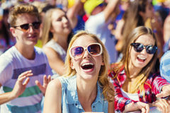 Beautiful teens at summer festival. Group of beautiful teens at concert at summer festival Stock Images