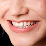 Beautiful teeth in a perfect smile. Beautiful white teeth in a perfect happy smile of a female face, dentist tooth whitening concept Stock Photography