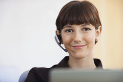 Beautiful Telephone Operator Wearing Headset Royalty Free Stock Photography