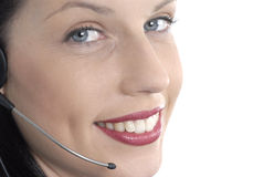 Telephone receptionist with headset microphone, close up, eyes looking at camera, white background Royalty Free Stock Image